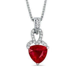 Heart shape red ruby gemstone with diamond pendant